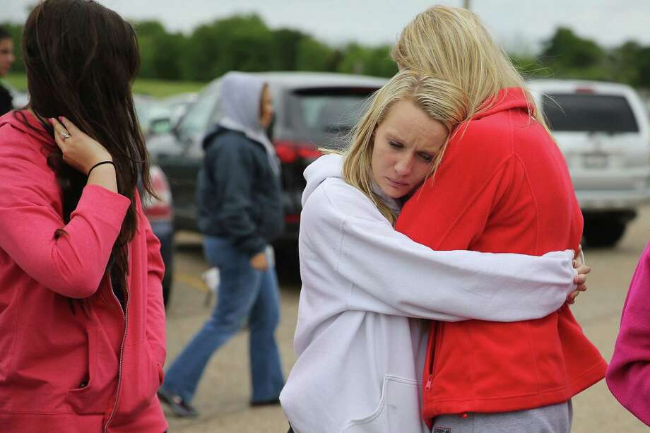 WEST, TX - APRIL 18:  West High School senior students Mackenzie Wernet (R) and Heather Perry embrace after praying for the victims and survivors the day after the West Fertilizer Company explosion April 18, 2013 in West, Texas. Wernet's home was destroyed when the fertilizer company caught fire and exploded, killing at least five people, injuring more than 160 people and leaving damaged buildings for blocks in every direction. Photo: Chip Somodevilla, Getty Images / 2013 Getty Images