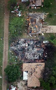Homes damaged from the explosion of the West Fertilizer plant are seen in an aerial view on Thursday, April 18, 2013, in West, Texas.  Photo: Smiley N. Pool, Houston Chronicle / © 2013  Houston Chronicle