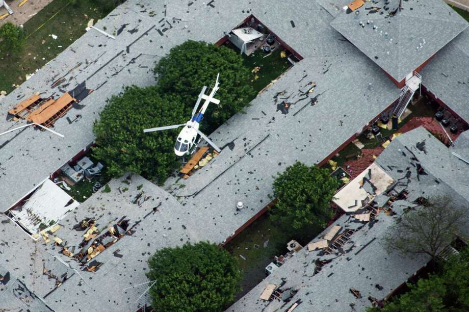 A law enforcement helicopter flies over a nursing home damaged from the explosion of the West Fertilizer plant on Thursday, April 18, 2013, in West, Texas.  Photo: Smiley N. Pool, Houston Chronicle / © 2013  Houston Chronicle