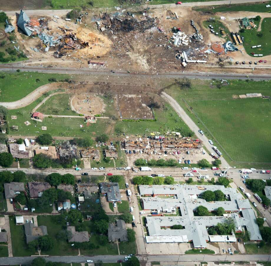 Damage from the explosion of the West Fertilizer plant, at top, is seen in an aerial view on Thursday, April 18, 2013, in West, Texas.  A nursing home is at bottom.  An apartment complex is at center.  Photo: Smiley N. Pool, Houston Chronicle / © 2013  Houston Chronicle