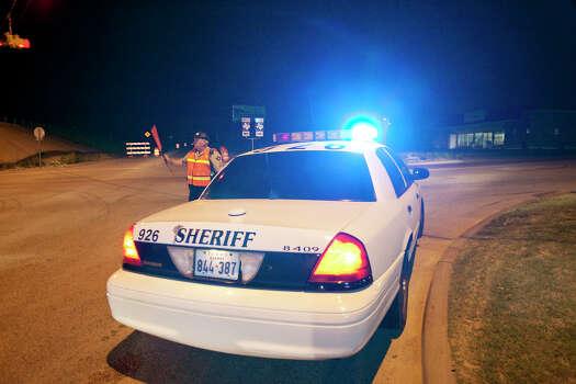 A local sheriff blocks Farm Road 2114 leading into West, Tx. after an explosion at a fertilizer plant Thursday April 18, 2013. Photo: Edward A. Ornelas, San Antonio Express-News / © 2013 San Antonio Express-News