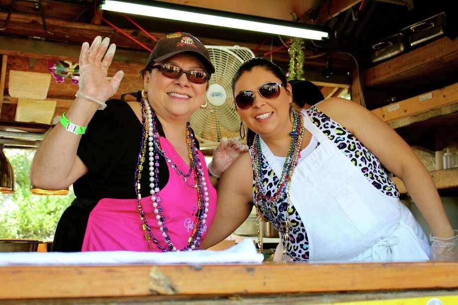 Revelers enjoy A Taste of New Orleans on Saturday, April 20, 2013, during Fiesta. Photo: Yvonne Zamora, MySA.com