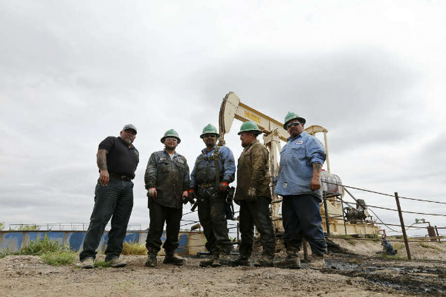 The crew from left, Sonny Sanchez, Mario Gonzalez, Ricky Chavarria, George Garcia and Robert Torrez pose by the completed a work over rig No. 7 at the Tortuga Ranch in Zavala County, Wednesday, March 27, 2013. Photo: Jerry Lara