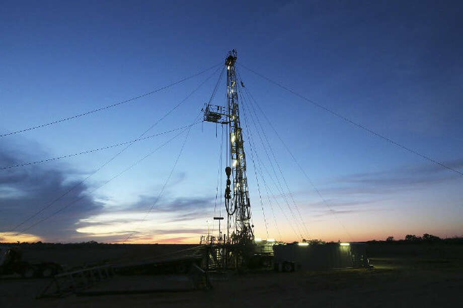 The sun sets on the drilling rig in Frio County, Sunday, Jan. 20, 2013. The drilling is funded by third-generation wildcatter, Harvey Howell of San Antonio. Photo: Jerry Lara, San Antonio Express-News