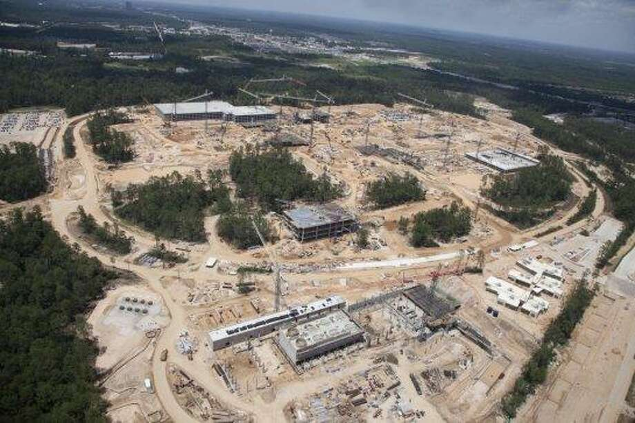 Summer 2012: These aerial photographs show the progress on Exxon Mobil's huge corporate campus south of The Woodlands. The 385-acre development is west of Interstate 45 near the Hardy Toll Road. It's being built to house at least 10,000 people and completion is schedueld for 2015 . An early estimate pegged the construction cost at more than $1.2 billion. Photo: Don Hoffman