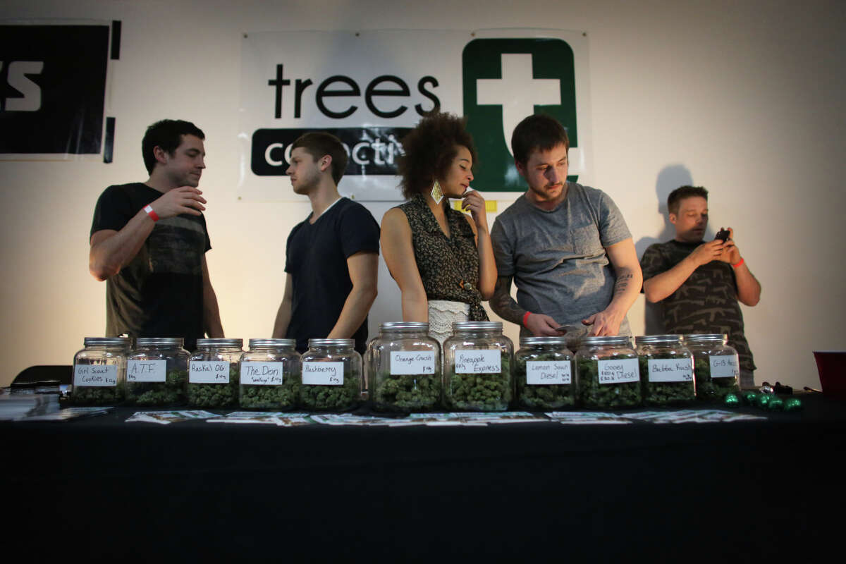 From left, Sam Carroll, Ross Skocilich, Aubrey McMillan and Sam LaQuet of Trees Collective work their booth, selling their product during