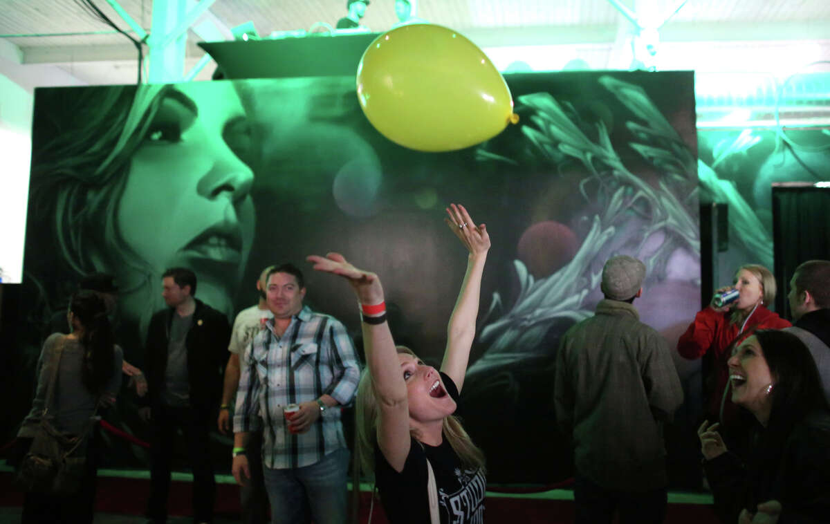 Participants play with a balloon during