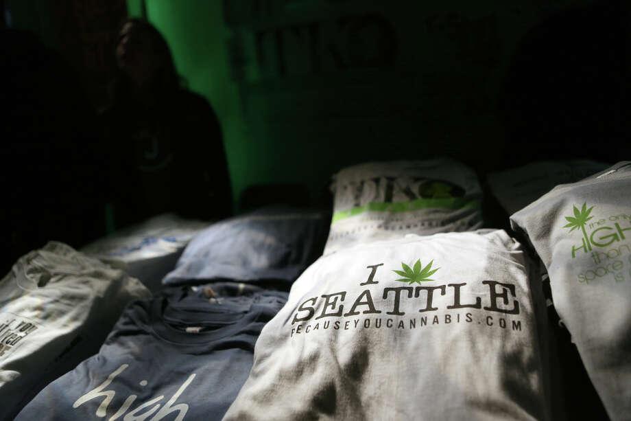 "T-shirts are sold during ""Studio 4/20,"" helping to market Washington, and Seattle as a marijuana destination. The legalization of marijuana is expected to create niche tourism in Washington and Colorado. Photo: JOSHUA TRUJILLO, SEATTLEPI.COM / SEATTLEPI.COM"