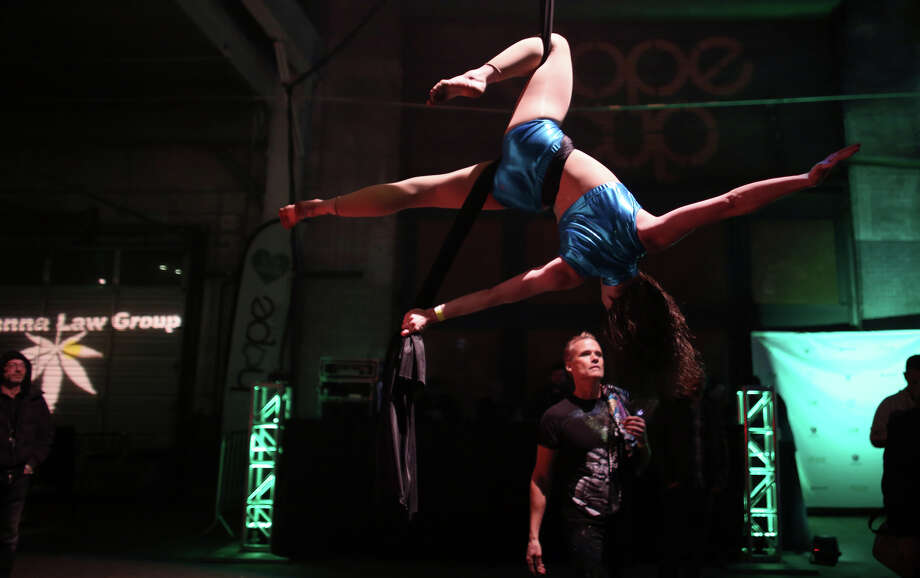 Aerial silk performer Kimberly Badgett performs during the party. Photo: JOSHUA TRUJILLO, SEATTLEPI.COM / SEATTLEPI.COM