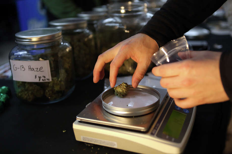 Marijuana from Trees Collective is weighed for distribution. Photo: JOSHUA TRUJILLO, SEATTLEPI.COM / SEATTLEPI.COM