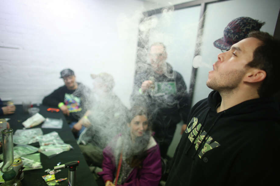 Participants smoke vaporized marijuana in a back room. Photo: JOSHUA TRUJILLO, SEATTLEPI.COM / SEATTLEPI.COM
