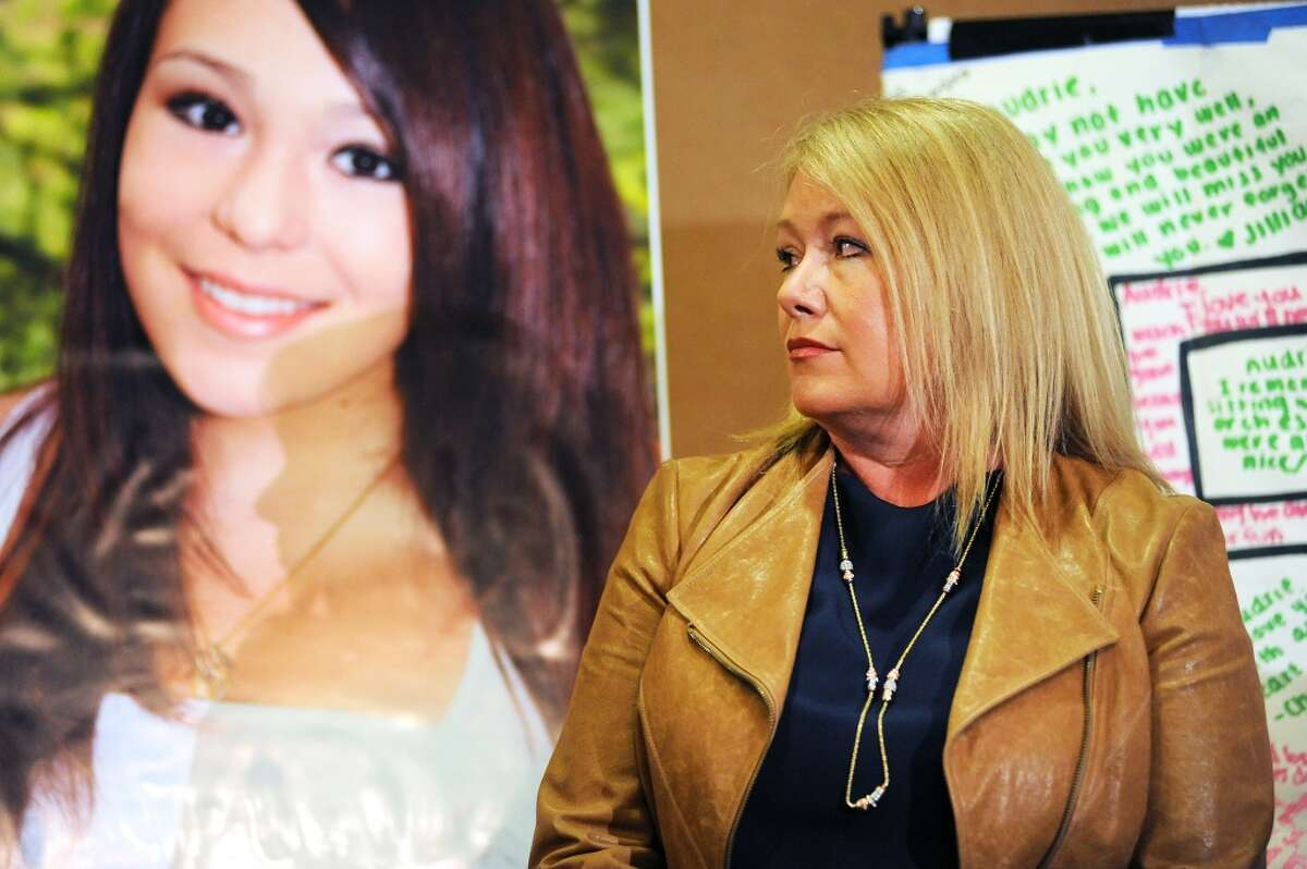 Audrie\'s mother Sheila Pott stands next to a photo of her daughter during a press conference at the Radisson Hotel in San Jose, CA Monday April 15th, 2013.