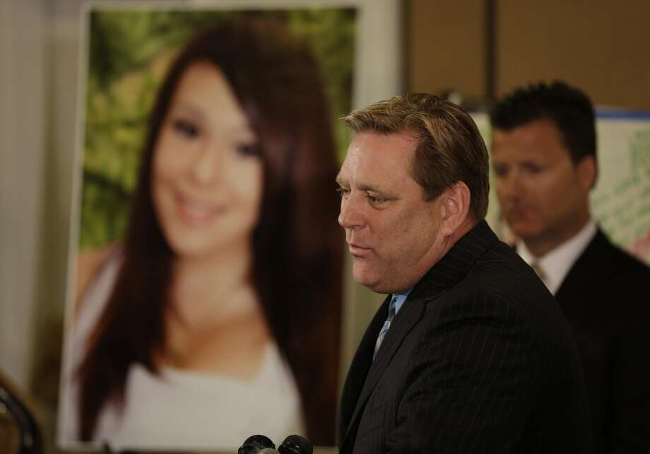 Larry Pott, father of Audrie Pott, who committed suicide after a sexual assault, talks about his daughter during a news conference Monday, April 15, 2013, in San Jose, Calif. At right is family representative Robert Allard. The family of a girl who committed suicide after she was sexually assaulted and a photo of the act was shared in text messages said Monday they hope to work for a stricter cyberbullying law in California.