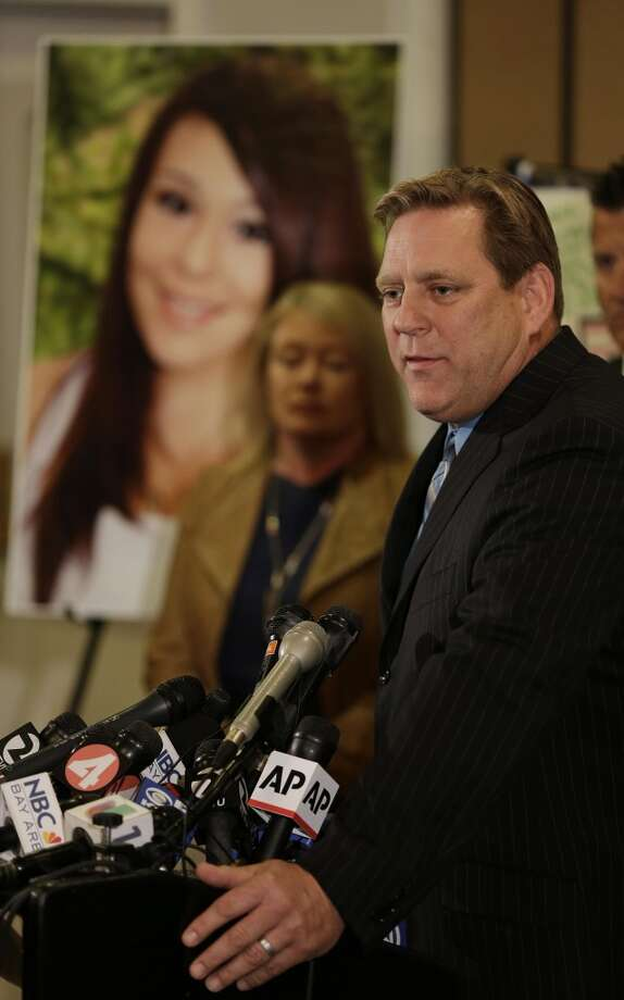Larry Pott, father of Audrie Pott who committed suicide after she was sexually assaulted, answers questions as Sheila Pott, left, Audrie\'s mother, looks on during a news conference Monday, April 15, 2013 in San Jose, Calif. The family of a girl who committed suicide after she was sexually assaulted and a photo of the act was shared in text messages said Monday the three 16-year-old boys responsible were sober when the assault happened. They said they were outraged by what they see as a refusal to take responsibility by the three boys arrested in the attack on the 15-year-old girl in Saratoga, a bedroom community on the fringe of Silicon Valley. (AP Photo/Eric Risberg)