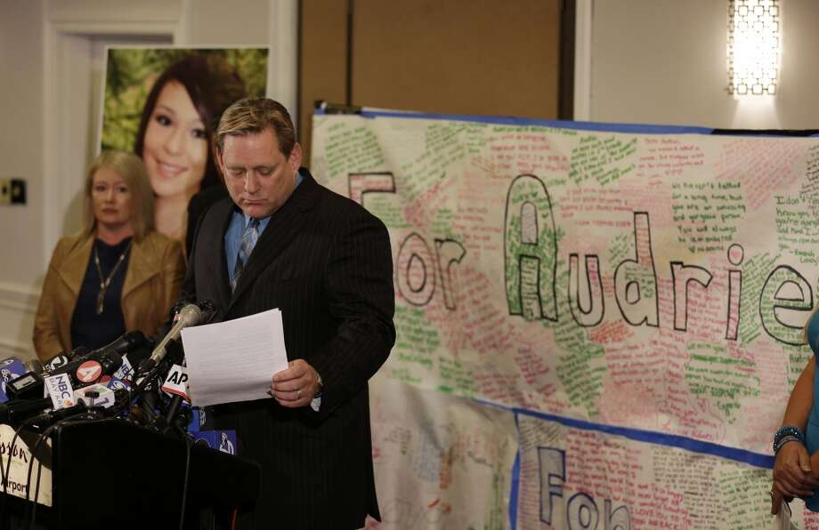 Larry Pott, father of Audrie Pott who committed suicide after she was sexually assaulted, reads a statement as Sheila Pott, left, Audrie\'s mother, looks on during a news conference Monday, April 15, 2013 in San Jose, Calif. The family of a girl who committed suicide after she was sexually assaulted and a photo of the act was shared in text messages said Monday the three 16-year-old boys responsible were sober when the assault happened. They said they were outraged by what they see as a refusal to take responsibility by the three boys arrested in the attack on the 15-year-old girl in Saratoga, a bedroom community on the fringe of Silicon Valley. (AP Photo/Eric Risberg)