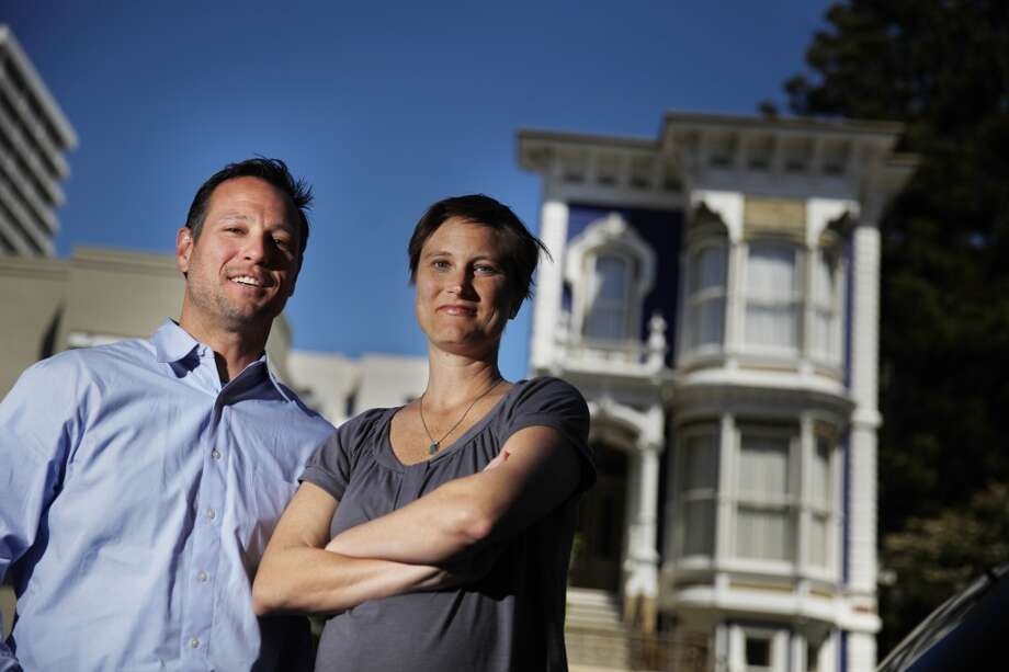 Ben Ladomirak, owner and president Teevan and Jessee Ladomirak, general manager Teevan, are seen in front of a Victorian home (background right) that Teevan restored and rebuilt on Thursday, April 18, 2013 in San Francisco, Calif.