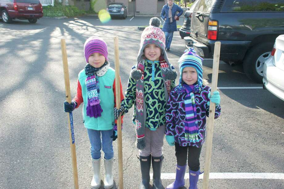 Caroline, Grace and Kate Nemec were among the helpers in the 2012 townwide cleanup, which this year will take place on Saturday, April 27, is sponsored by the Darien Beautification Commission and the Chamber of Commerce. Photo: Contributed