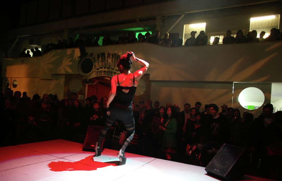 "Performer Cherry Markos dances on stage during ""Studio 4/20,"" a legal marijuana celebration. Photo: JOSHUA TRUJILLO, SEATTLEPI.COM / SEATTLEPI.COM"