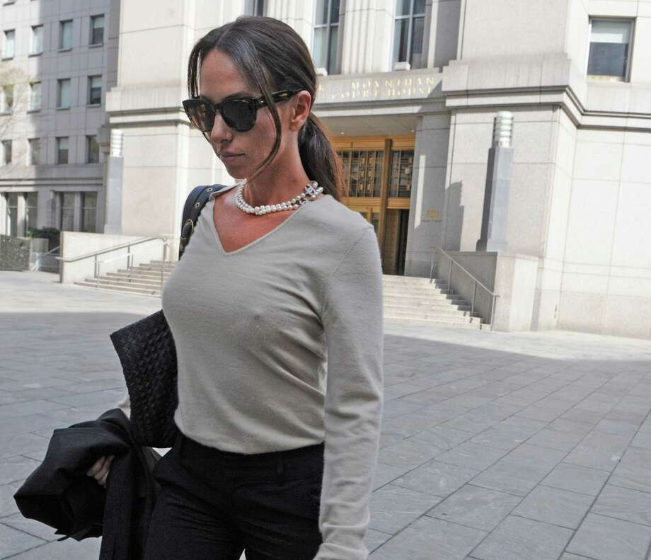 "Molly Bloom exits Manhattan federal court, Friday, April 19, 2013, in New York. Nearly three dozen people were charged on Tuesday in what investigators said was a Russian organized crime operation that included illegal, high-stakes poker games for the rich and famous and threats of violence to make sure customers paid their debts. Bloom has been dubbed the ""sexy poker princess."" She pleaded not guilty on Friday to changes of illegal gambling. She has been previously linked to such A-list card sharks as Leonardo DiCaprio, Alex Rodriguez, Tobey Maguire and Matt Damon. She declined comment after her arraignment in Manhattan Federal Court. Photo: AP"