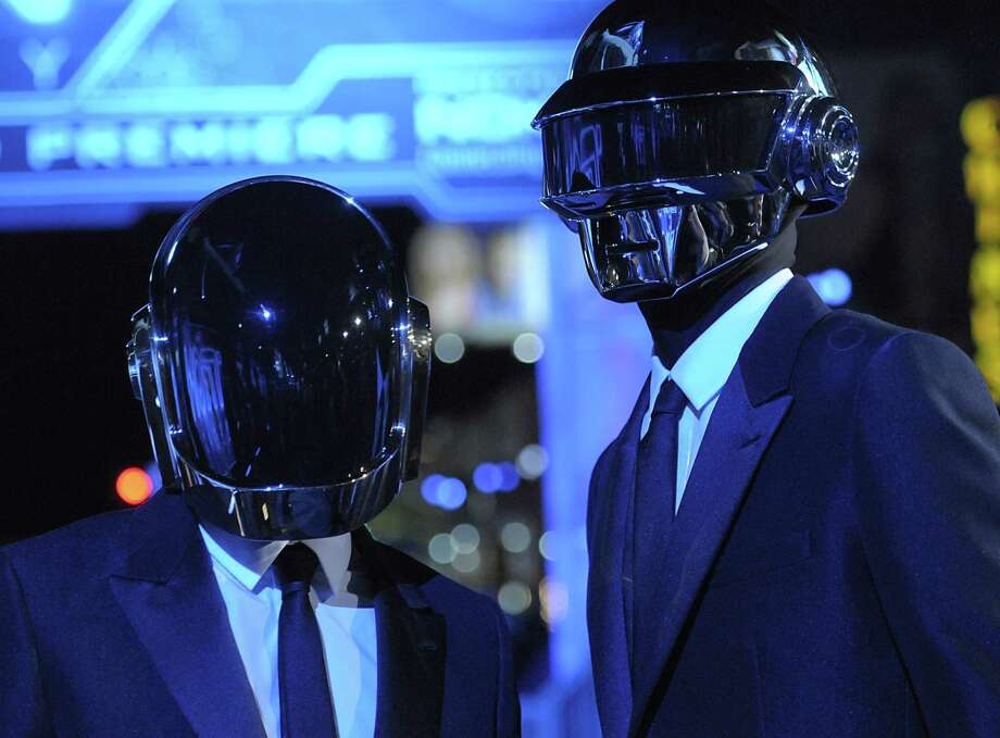 "In this Dec. 11, 2010 file photo, musician Guy-Manuel de Homem-Christo, left, and musician Thomas Bangalter of the duo Daft Punk arrive at the premiere of the feature film ""Tron: Legacy"" in Los Angeles.  Daft Punk have set a record on Spotify. The music service says the French electronic duo's song, ""Get Lucky,"" had the biggest streaming day for a single track on Friday, April 19, 2013,  in the United States and the United Kingdom. Spotify wouldn't release the number of streams. Photo: AP"