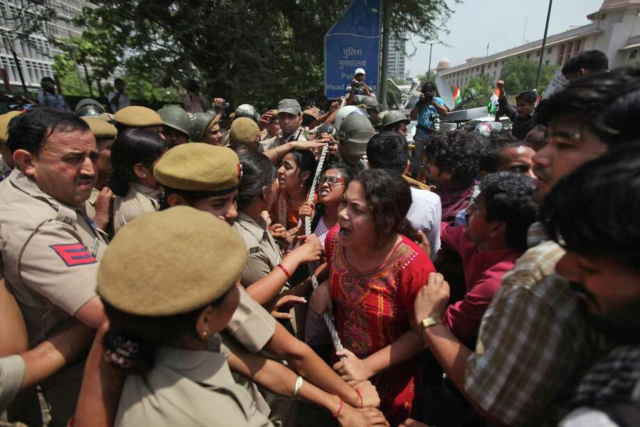 Indian protesters try to force their way inside Delhi Police headquarters during a protest against the rape of a 5-year-old girl in New Delhi, India, Saturday, April 20, 2013. Officials say the child is in serious condition after being raped and tortured by a man who held her in a locked room in India's capital for two days. Police say the girl went missing Monday and was found Wednesday by neighbors who heard her crying in a room in the same New Delhi building where she lives with her parents. Photo: AP