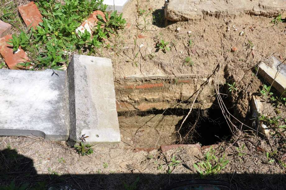 This undated photo provided by the Burke County Sheriff's Office shows a desecrated grave at the Old Church Cemetery near Waynesboro, Ga. Caretakers at the Old Church Cemetery, one of Georgia's oldest cemeteries, are offering a reward for information leading to the suspects who desecrated several graves, leaving bones exposed and the uniform of a buried soldier lying on the ground. Photo: AP