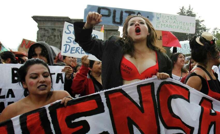 Women chant slogans during a