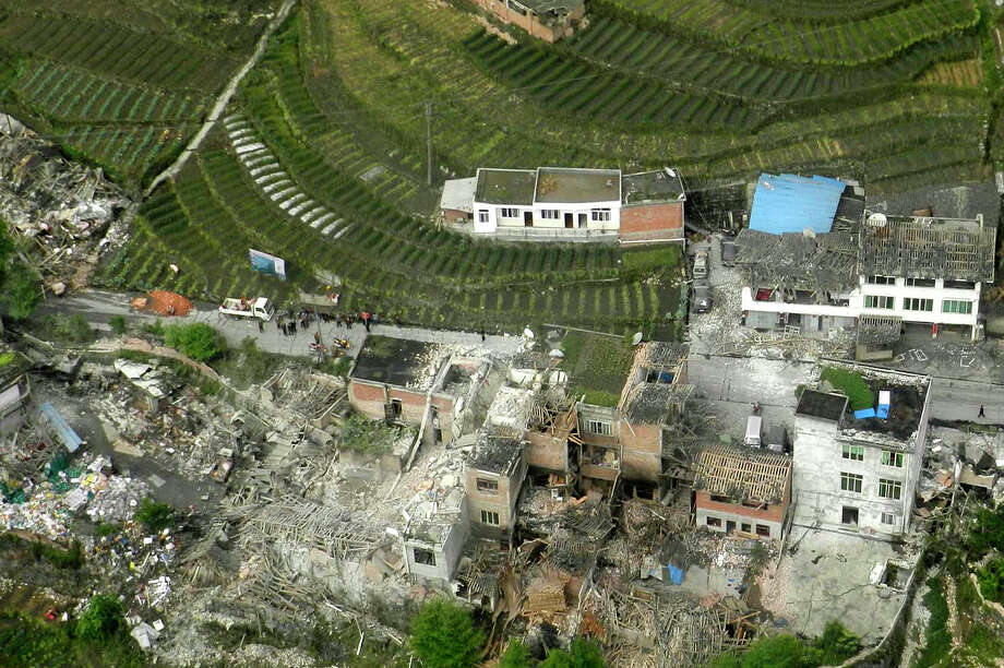 This aerial photo released by China's Xinhua news agency shows destroyed houses after a powerful earthquake hit Taiping town of Lushan County in Ya'an City, southwest China's Sichuan Province, Saturday, April 20, 2013. The powerful earthquake jolted Sichuan province Saturday near where a devastating quake struck five years ago. (AP Photo/Xinhua, Liu Yinghua) Photo: AP