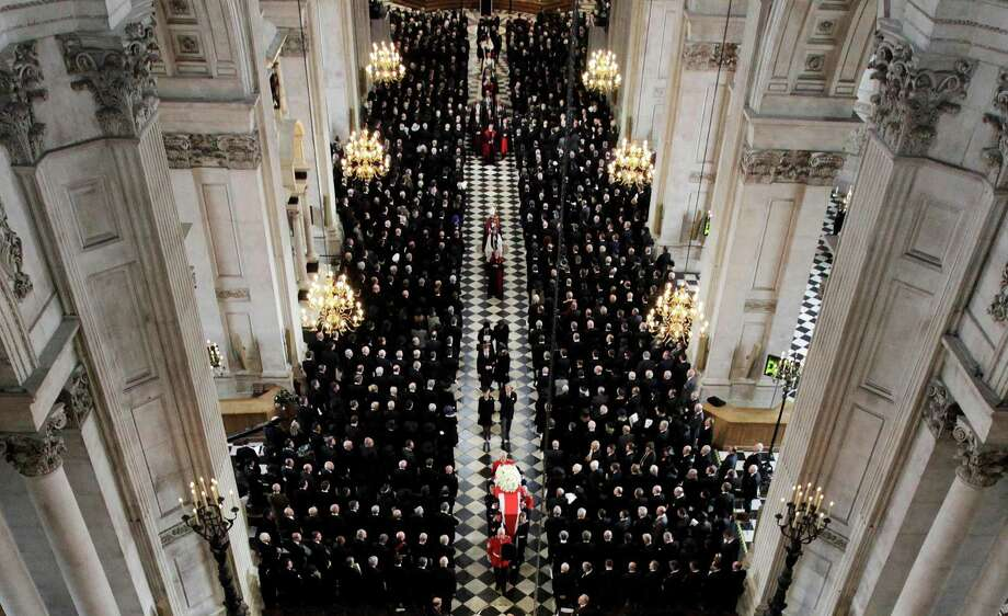 The coffin of former British prime minister Margaret Thatcher is carried by the Bearer Party as it leaves St Paul's Cathedral after her funeral service, in London April 17, 2013 Thatcher, who was Conservative prime minister between 1979 and 1990, died on April 8 at the age of 87. Photo: AP