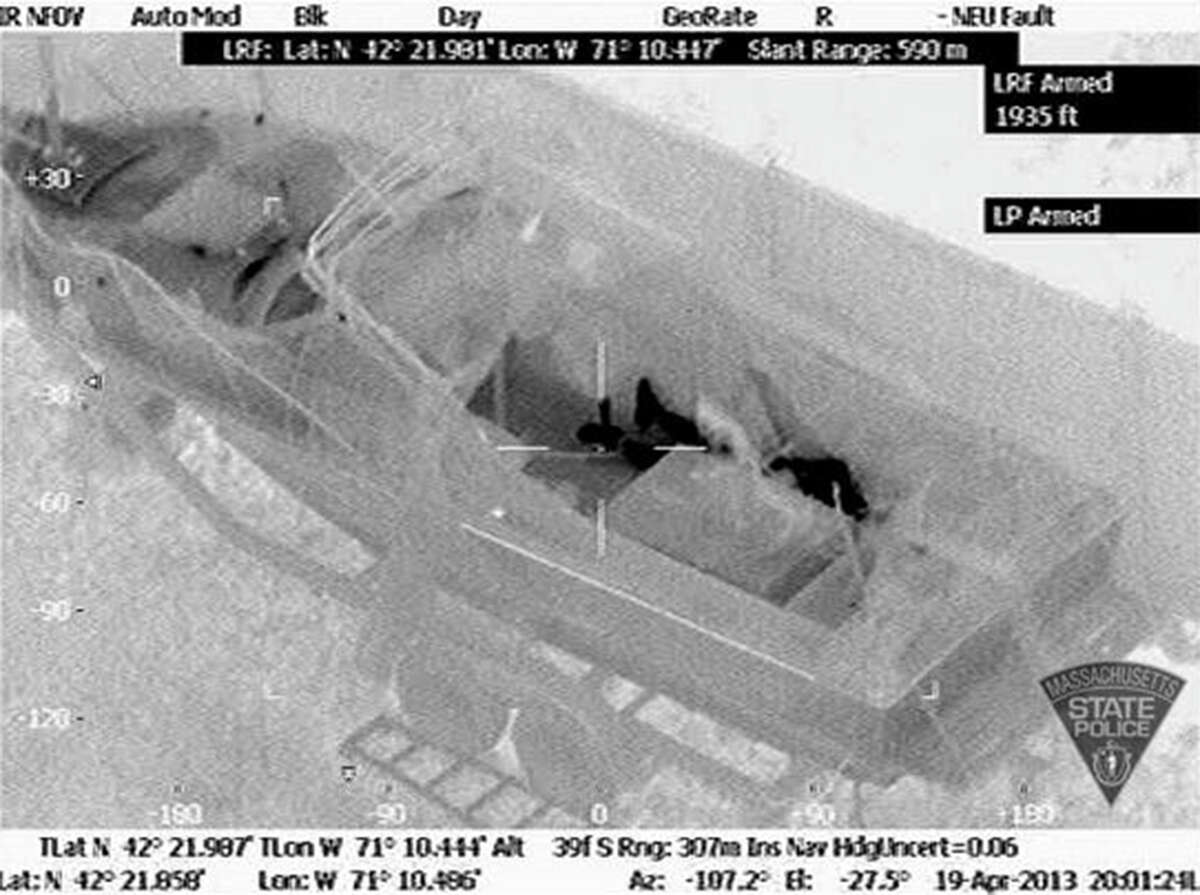 This Friday, April 19, 2013 image made available by the Massachusetts State Police shows 19-year-old Boston Marathon bombing suspect, Dzhokhar Tsarnaev, hiding inside a boat during a search for him in Watertown, Mass. He was pulled, wounded and bloody, from the boat parked in the backyard of a home in the Greater Boston area. His capture put an end to the hunt for the Boston Marathon bombers.