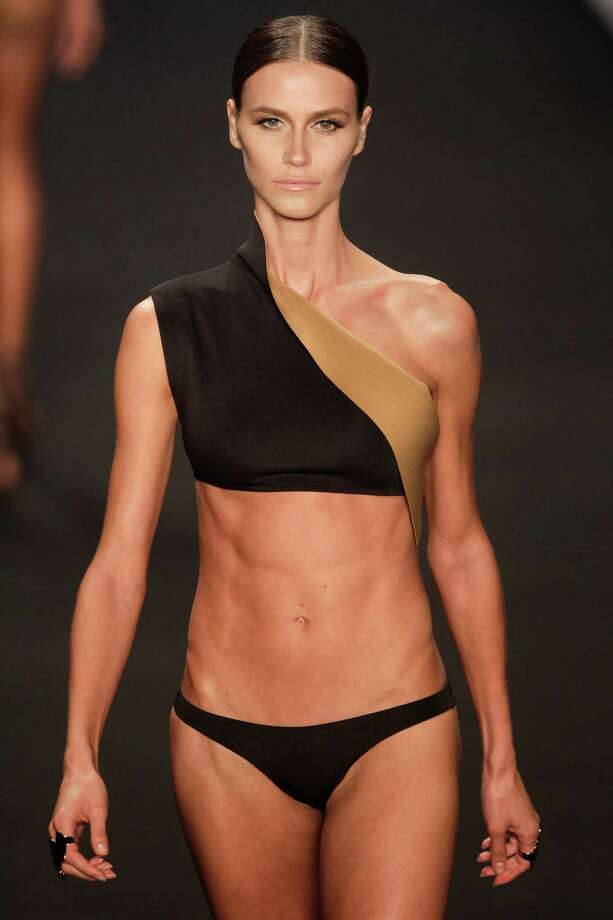 A model wears a creation from the Lenny summer collection during Fashion Rio in Rio de Janeiro, Brazil, Wednesday, April 17, 2013. While still almost alarmingly itsy-bitsy by American standards, Lenny's bikinis are less revealing than most bikinis in Brazil, and less flashy and cutesy than the bubblegum pink offerings of many local swimwear labels.  (AP Photo/Felipe Dana) Photo: Multiple