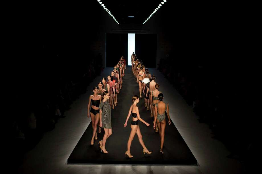 Models wear creations from the Lenny summer collection during Fashion Rio in Rio de Janeiro, Brazil, Wednesday, April 17, 2013. (AP Photo/Felipe Dana) Photo: Multiple