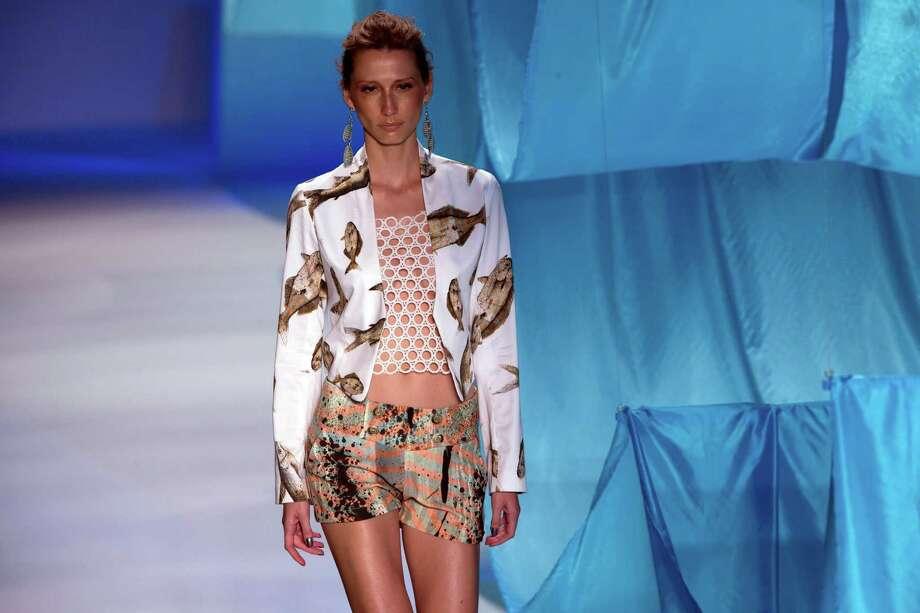 A model wears a creation from Nica Kessler summer collection during Fashion Rio, in Rio de Janeiro, Brazil, Thursday, April 18, 2013. (AP Photo/Silvia Izquierdo) Photo: Multiple