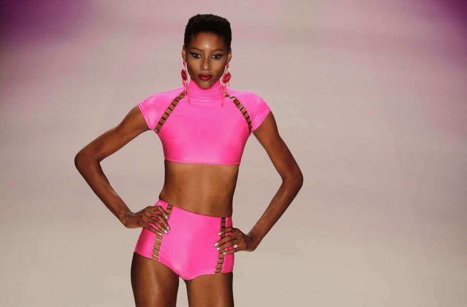 A model wears a creation from the Triya summer collection during Fashion Rio in Rio de Janeiro, Brazil, Friday, April 19, 2013. (AP Photo/Felipe Dana) Photo: Multiple