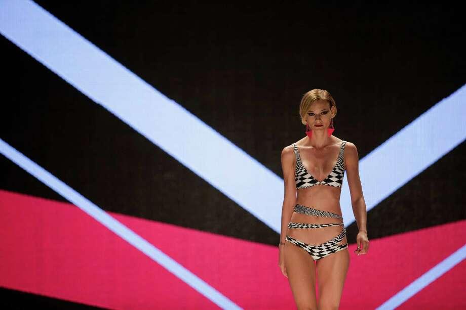 A model wears a creation from the Triya summer collection during Fashion Rio in Rio de Janeiro, Brazil, Friday, April 19, 2013. (AP Photo/Felipe Dana) Photo: Multiple