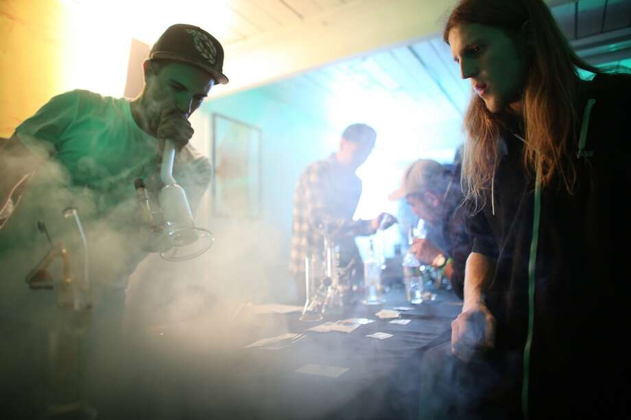 "4/20, a marijuana holiday of sorts, was celebrated in Seattle for the first time since pot was legalized by Washington voters. The state is still working on rules for growing and distribution of legal pot.  Nick Villejo of Refine and Jared Smith smoke marijuana during ""Studio 4/20,"" a legal marijuana celebration put on by DOPE Magazine at 7 Point Studios on April 20, 2013 on South Dearborn Street. The event billed itself as the largest local marijuana celebration since pot was legalized by Washington voters. (Joshua Trujillo, seattlepi.com) Photo: JOSHUA TRUJILLO, SEATTLEPI.COM"