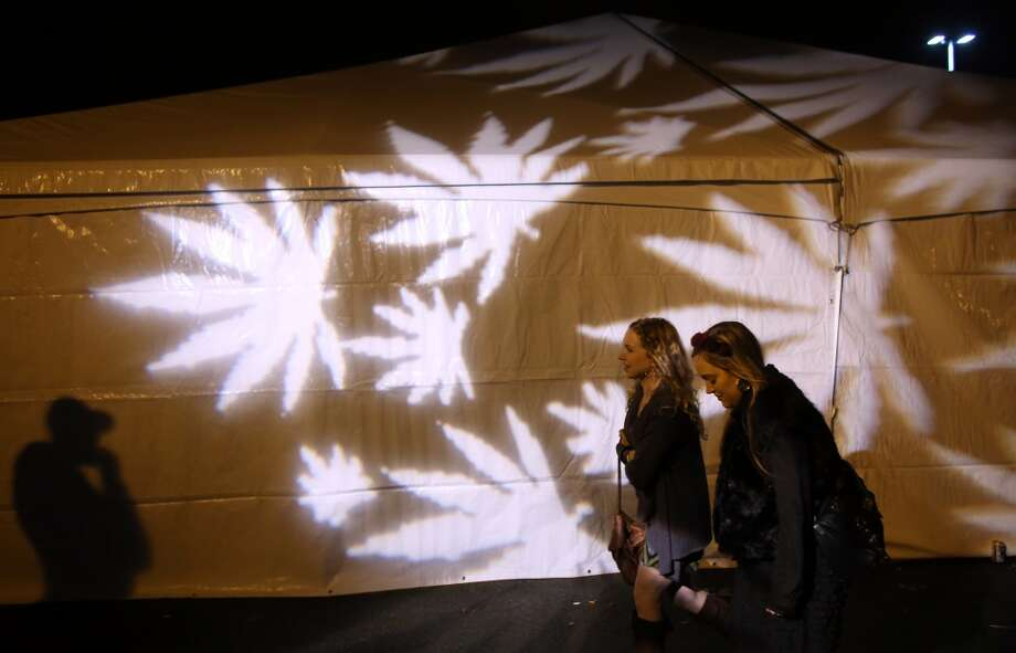 "Participants walk past the outdoor smoking tent during ""Studio 4/20,"" a legal marijuana celebration put on by DOPE Magazine at 7 Point Studios on April 20, 2013 on South Dearborn Street. The event billed itself as the largest local marijuana celebration since pot was legalized by Washington voters. (Joshua Trujillo, seattlepi.com) Photo: JOSHUA TRUJILLO, SEATTLEPI.COM"