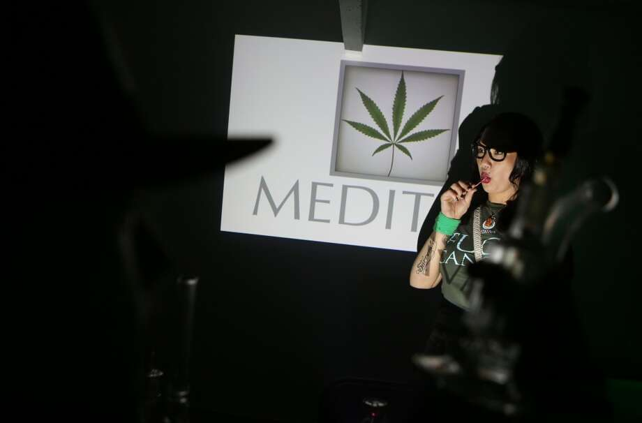 "Rachel Rensvold of Meditiva works at her booth during ""Studio 4/20,"" a legal marijuana celebration put on by DOPE Magazine at 7 Point Studios on April 20, 2013 on South Dearborn Street. The event billed itself as the largest local marijuana celebration since pot was legalized by Washington voters. (Joshua Trujillo, seattlepi.com) Photo: JOSHUA TRUJILLO, SEATTLEPI.COM"