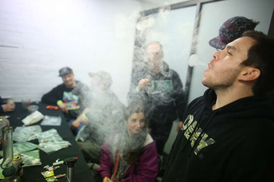 "Participants smoke vaporized marijuana during ""Studio 4/20,"" a legal marijuana celebration put on by DOPE Magazine at 7 Point Studios on April 20, 2013 on South Dearborn Street. The event billed itself as the largest local marijuana celebration since pot was legalized by Washington voters. (Joshua Trujillo, seattlepi.com) Photo: JOSHUA TRUJILLO, SEATTLEPI.COM"