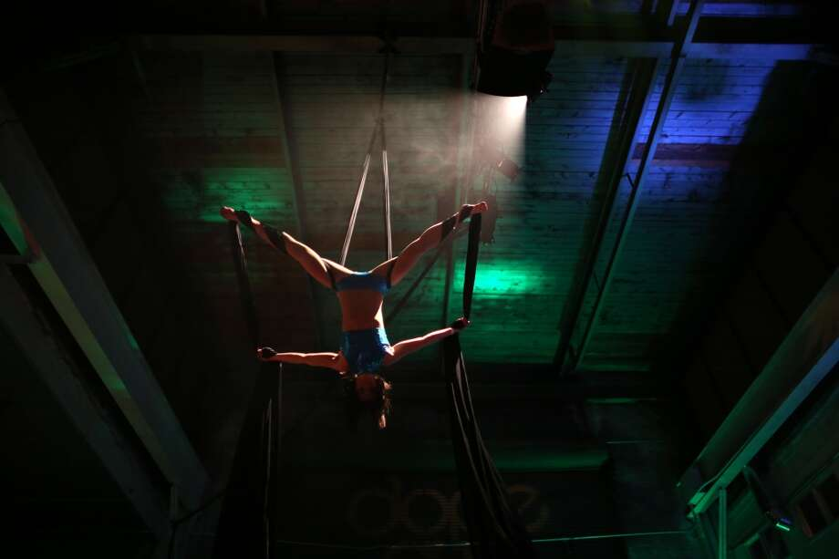 "Aerial silk performer Kimberly Badgett performs during ""Studio 4/20,"" a legal marijuana celebration put on by DOPE Magazine at 7 Point Studios on April 20, 2013 on South Dearborn Street. The event billed itself as the largest local marijuana celebration since pot was legalized by Washington voters. (Joshua Trujillo, seattlepi.com) Photo: JOSHUA TRUJILLO, SEATTLEPI.COM"