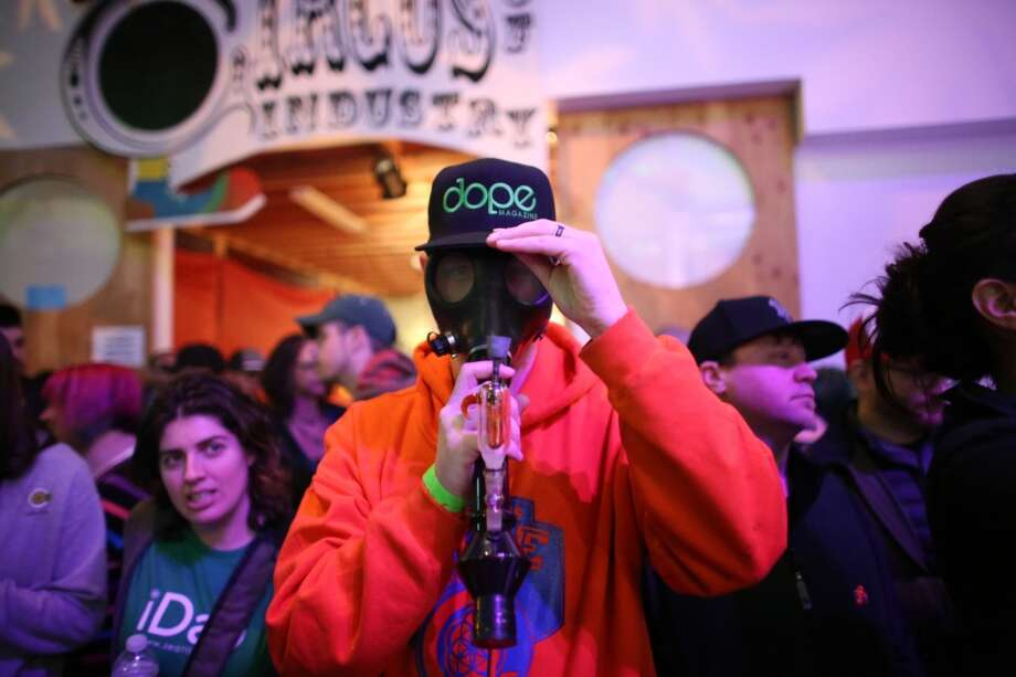 "A participant wears a smoking mask during ""Studio 4/20,"" a legal marijuana celebration put on by DOPE Magazine at 7 Point Studios on April 20, 2013 on South Dearborn Street. The event billed itself as the largest local marijuana celebration since pot was legalized by Washington voters. (Joshua Trujillo, seattlepi.com) Photo: JOSHUA TRUJILLO, SEATTLEPI.COM"