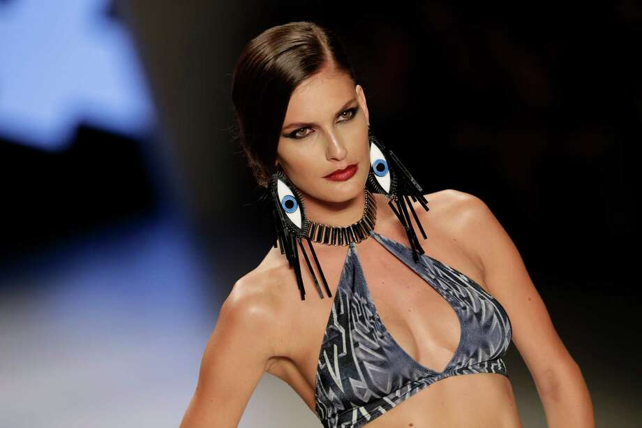A model, wears a design of Triya at Fashion Rio. Photo: Getty