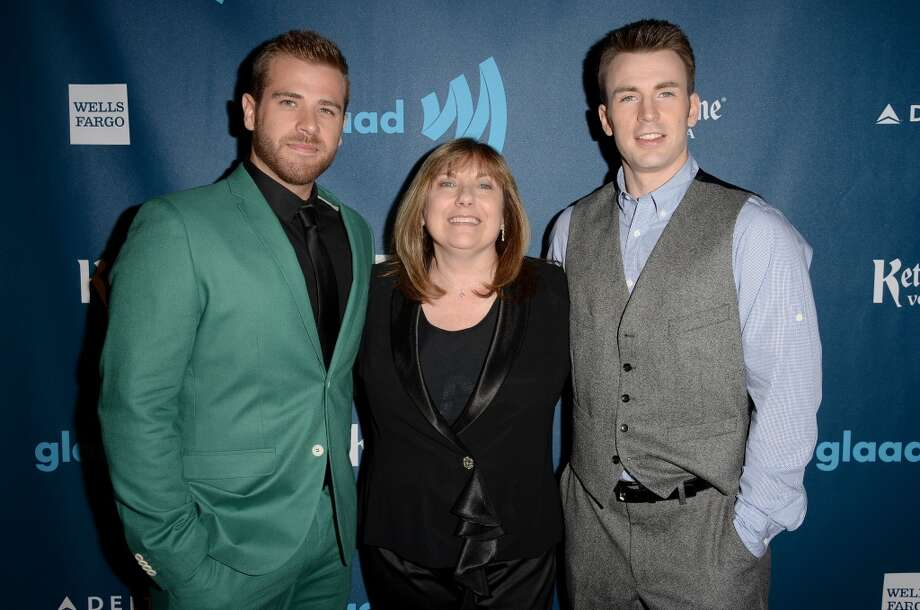 LOS ANGELES, CA - APRIL 20:  Actors Scott Evans (L) and Chris Evans (R) with mother Lisa Evans (C) pose in the VIP Red Carpet Suite at the 24th Annual GLAAD Media Awards hosted by Ketel One at JW Marriott Los Angeles at L.A. LIVE on April 20, 2013 in Los Angeles, California.  (Photo by Jason Merritt/Getty Images for GLAAD)