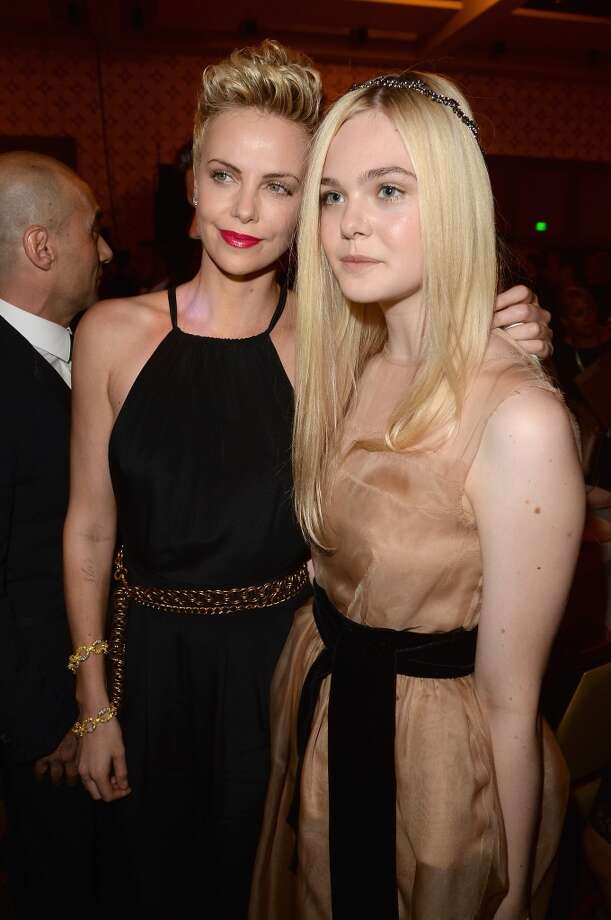 LOS ANGELES, CA - APRIL 20:  Actresses Charlize Theron and Elle Fanning attend the 24th Annual GLAAD Media Awards presented by Ketel One and Wells Fargo at JW Marriott Los Angeles at L.A. LIVE on April 20, 2013 in Los Angeles, California.  (Photo by Jason Merritt/Getty Images for GLAAD)