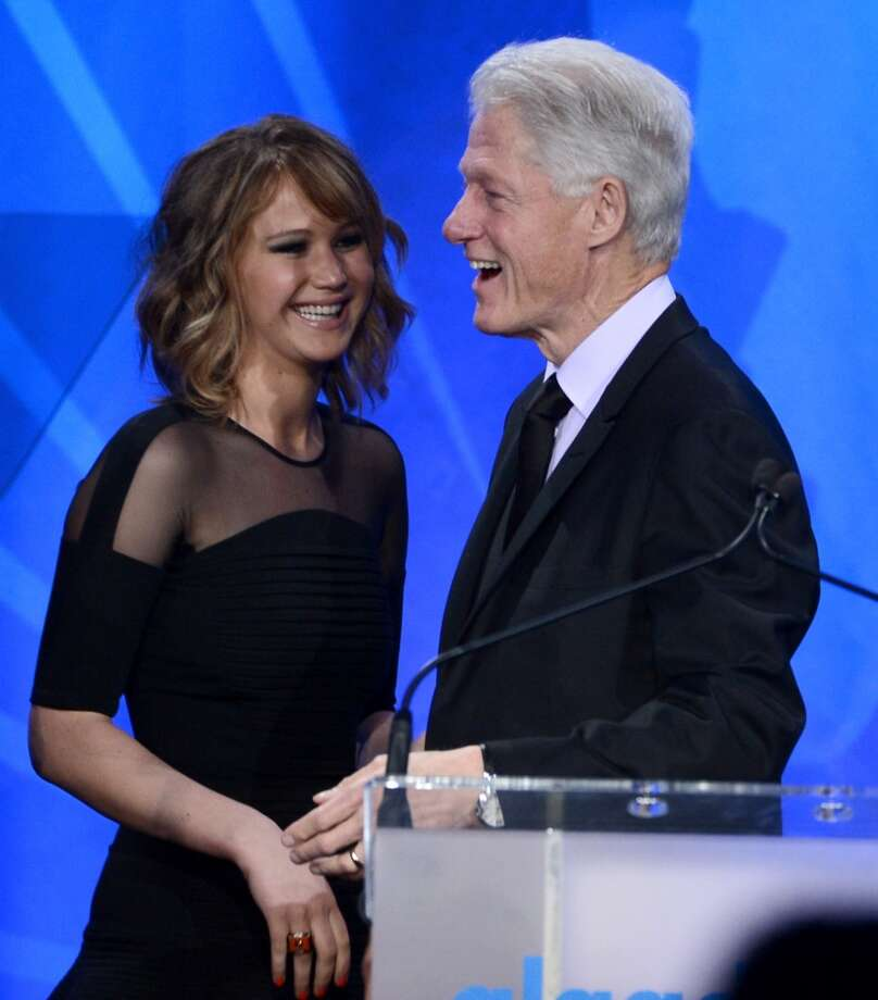 Actress Jennifer Lawrence presents Former President of the United States Bill Clinton with the Advocate for Change Award onstage during the 24th Annual GLAAD Media Awards presented by Ketel One and Wells Fargo at JW Marriott Los Angeles at L.A. LIVE on April 20, 2013 in Los Angeles, California.  (Photo by Kevin Winter/Getty Images for GLAAD)