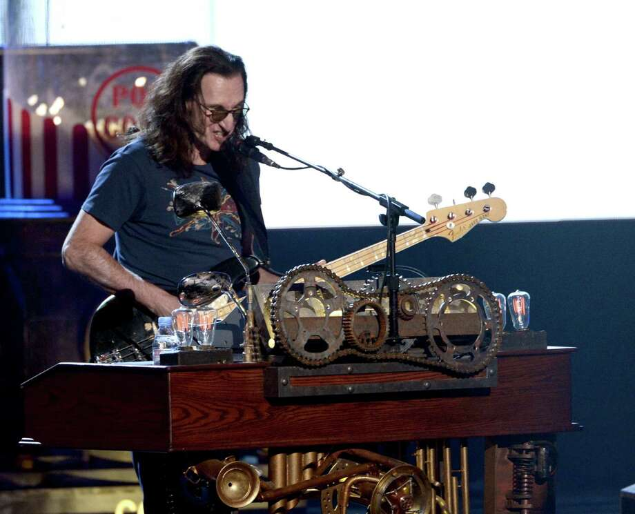Inductee Geddy Lee of Rush performs onstage at the 28th Annual Rock and Roll Hall of Fame Induction Ceremony at Nokia Theatre L.A. Live on April 18, 2013 in Los Angeles, California. Photo: Kevin Winter, Getty Images / 2013 Getty Images