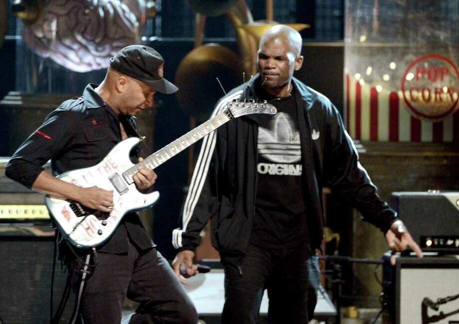 "Musicians Tom Morello and Darryl ""D.M.C."" McDaniels perform onstage at the 28th Annual Rock and Roll Hall of Fame Induction Ceremony at Nokia Theatre L.A. Live on April 18, 2013 in Los Angeles, California. Photo: Kevin Winter, Getty Images / 2013 Getty Images"