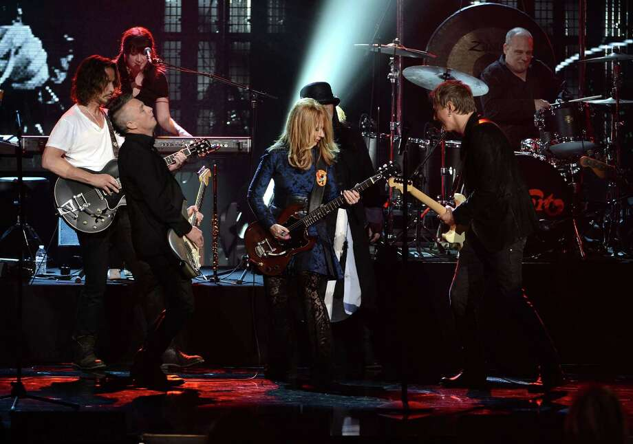 (L-R) Musicians Chris Cornell and Mike McCready of Pearl Jam and inductees Nancy Wilson, Ann Wilson and Jerry Cantrell of Heart perform on stage at the 28th Annual Rock and Roll Hall of Fame Induction Ceremony at Nokia Theatre L.A. Live on April 18, 2013 in Los Angeles, California. Photo: Kevin Winter, Getty Images / 2013 Getty Images
