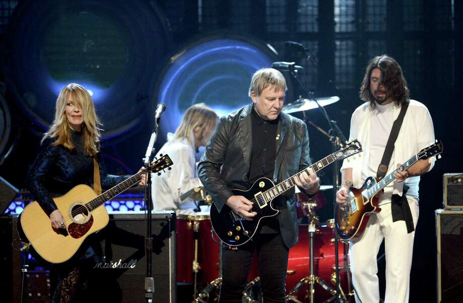 (L-R) Inductees Nancy Wilson of Heart and Alex Lifeson of Rush and musician Dave Grohl of Foo Fighters perform onstage at the 28th Annual Rock and Roll Hall of Fame Induction Ceremony at Nokia Theatre L.A. Live on April 18, 2013 in Los Angeles, California. Photo: Kevin Winter, Getty Images / 2013 Getty Images