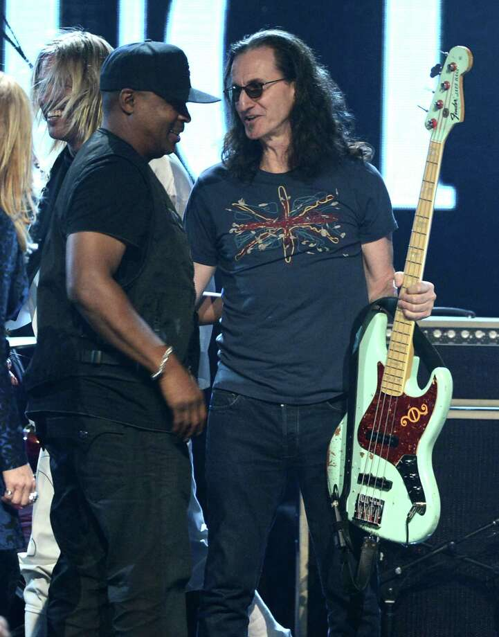 Inductees Chuck D of Public Enemy (L) and Geddy Lee of Rush perform on stage at the 28th Annual Rock and Roll Hall of Fame Induction Ceremony at Nokia Theatre L.A. Live on April 18, 2013 in Los Angeles, California. Photo: Kevin Winter, Getty Images / 2013 Getty Images